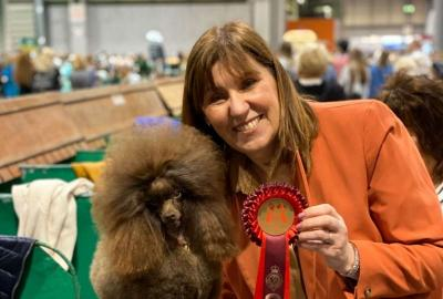 Lynne Land and groomed poodle